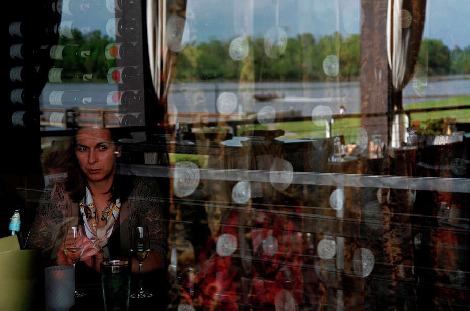 Patrons at The Tasting Room can view Lake Houston while they eat at The Tasting Room on Wednesday, April 4, 2012, in Kingwood. ( Mayra Beltran / Houston Chronicle ) Photo: Mayra Beltran, Houston Chronicle / © 2012 Houston Chronicle