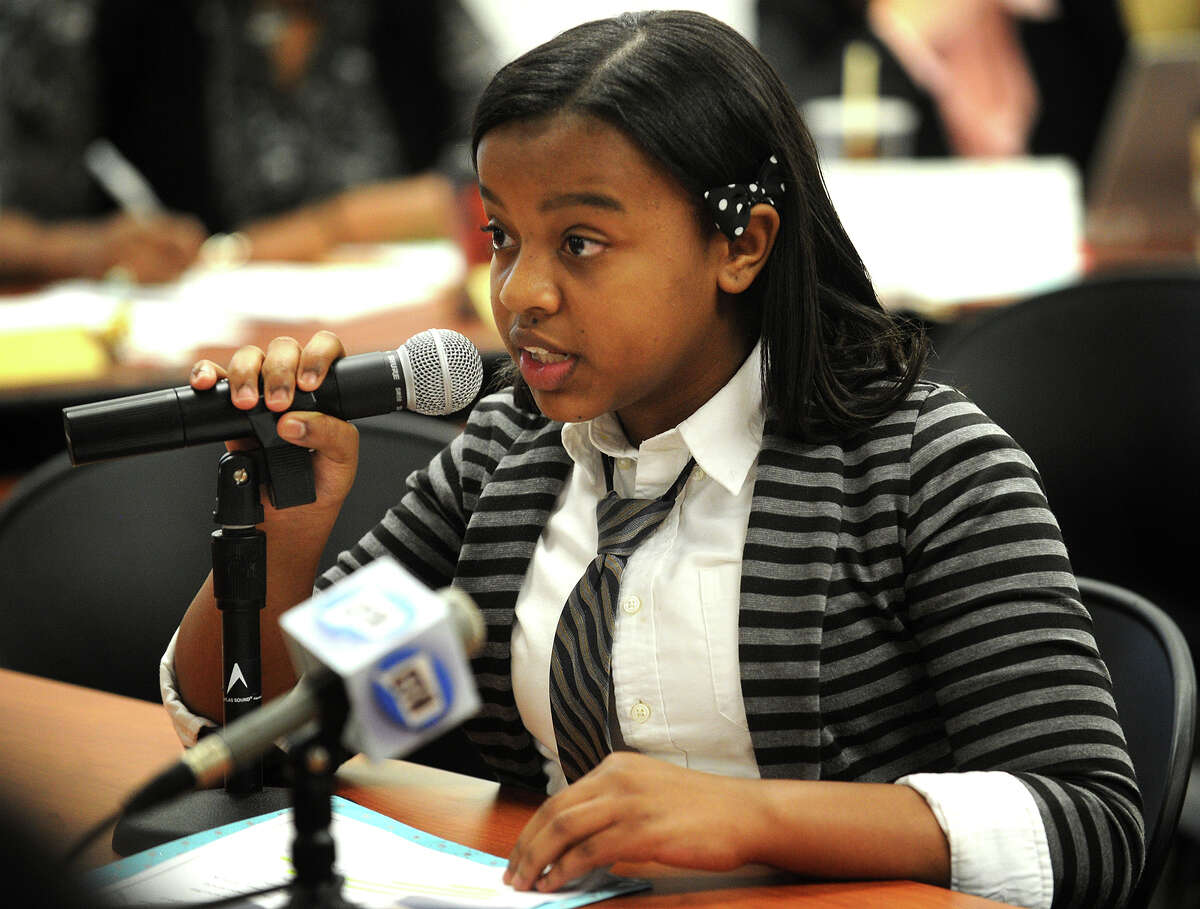 Simone Moales, 11, of Bridgeport, daughter of Bridgeport Board of Education member Kenneth Moales, Jr., speaks in support of proposed charter school Capital Prep in front of the State Board of Edcation in Hartford, Conn. on Wednesday, April 2, 2014.