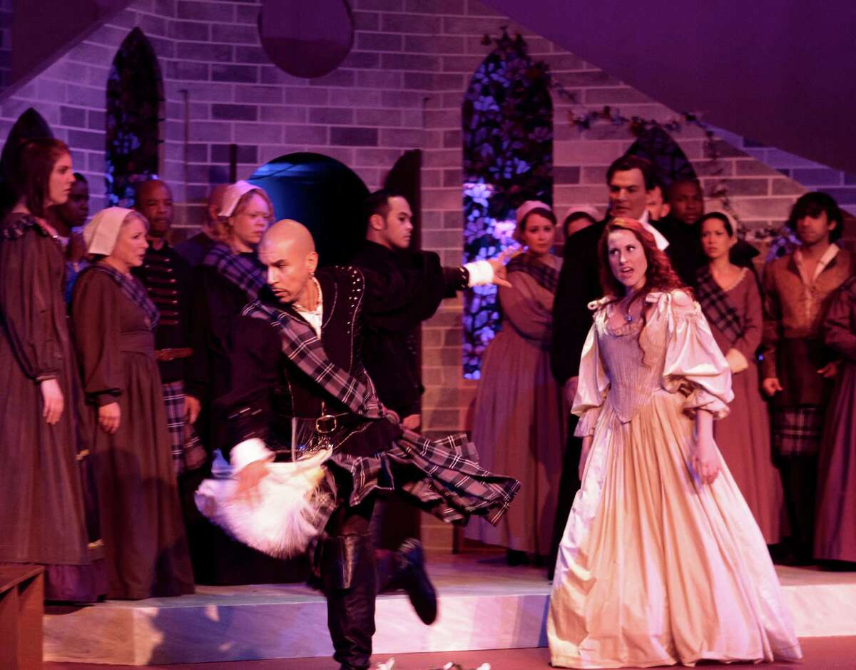 """Lucia (Jessica Jones) directs her anger at her brother Enrico (Octavio Moreno) in Opera in the Heights' staging of Gaetano Donizetti's """"Lucia di Lammermoor."""""""