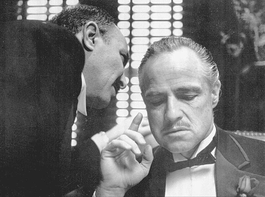 EMBARGOED UNTIL 11 P.M. EDT, JUNE 16, 1998--FILE--Bonasera, portrayed by Frank Puglia, asks Don Corleone, portrayed by Marlon Brando, at right, for a favor in a scene from the 1972 movie 'The Godfather'.    (AP Photo/Paramount Pictures, Files) / PARAMOUNT PICTURES