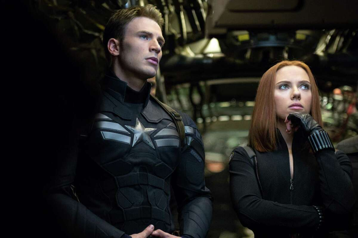 This image released by Marvel shows Chris Evans, left, and Scarlett Johansson in a scene from