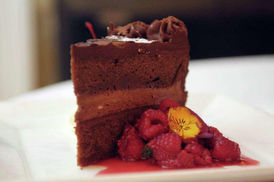 A triple chocolate layer cake with raspberry jam  at the Stockade Inn on Wednesday, Dec. 28, 2011 in Schenectady, NY.   (Paul Buckowski / Times Union) Photo: Paul Buckowski / 00015924A