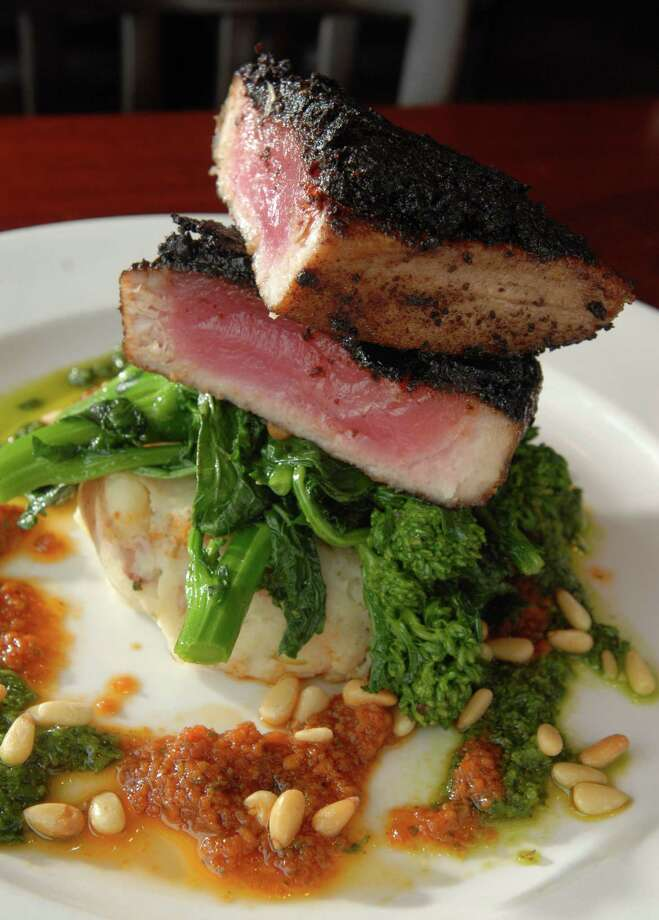 Beauty shot of the Nyon Olive Crusted Ahi Tuna Steak from the Big Plates section of the menu at the New World Bistro Bar on Thursday, June 18, 2009, on Delaware Ave. in Albany, NY.  (Luanne M. Ferris / Times Union) Photo: LMF / 00004415A