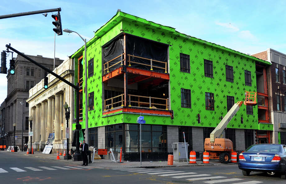Architectural firm Fletcher-Thompson is in the process of renovating the former Mechanics & Farmers Bank building in downtown Bridgeport. Photo: Christian Abraham / Connecticut Post