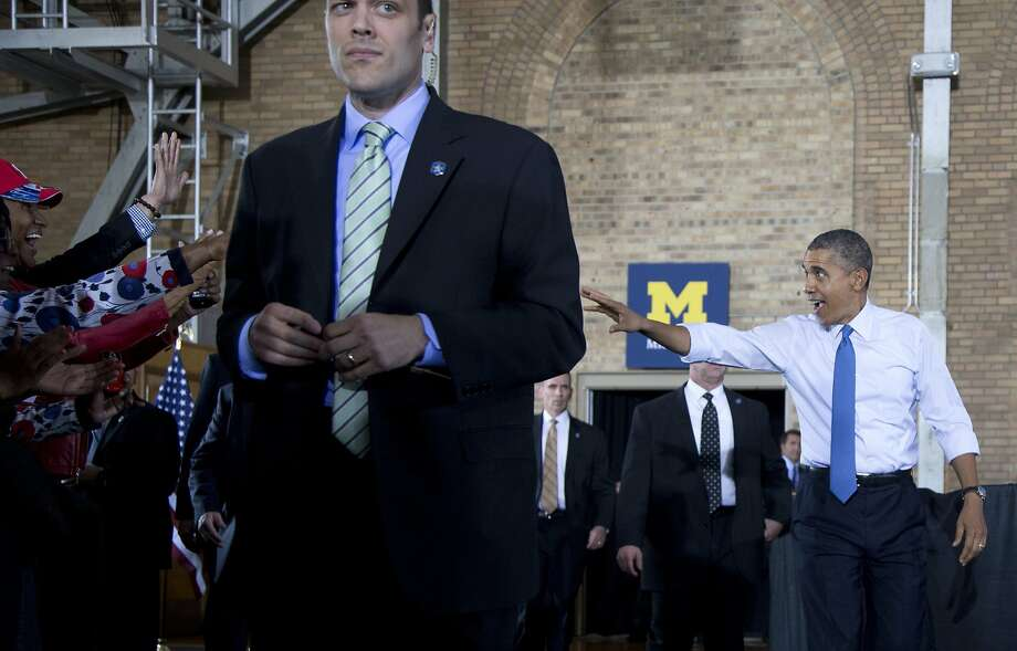President Barack Obama waves as he arrives to speak at the University of Michigan, Wednesday, April 2, 2014, in Ann Arbor, Mich., about his proposal to raise the national minimum wage. (AP Photo/Carolyn Kaster) Photo: Carolyn Kaster, Associated Press