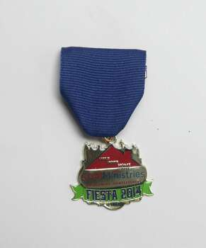 SAMMinistries' first Fiesta medal will be sold for $5 at its Furniture for a Cause store, 5254 Blanco Road, and proceeds will be used to fund its homeless prevention services. www.samm.org. Photo: Juanito M. Garza, San Antonio Express-News / San Antonio Express-News