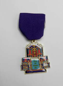 San Fernando Cathedral celebrates the historic church's annual Fiesta San Fernando, April 23-26, at Main Plaza. The medal, $7, and pin, $5, are available at the Fiesta Store, San Fernando Gift Shop and the Prestigious Mark, 8603 N. New Braunfels. www.catholicearth.com/sfcathedral. Photo: Juanito M. Garza, San Antonio Express-News / San Antonio Express-News
