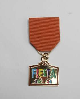 "University of Texas Co-op Fiesta medal is available at the store at the Alamo Quarry Market, and notes that it's an ""exclusive limited edition."" Photo: Juanito M. Garza, San Antonio Express-News / San Antonio Express-News"