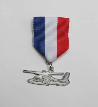 U.S. Coast Guard Fiesta medal, not for sale. Photo: Juanito M. Garza, San Antonio Express-News / San Antonio Express-News
