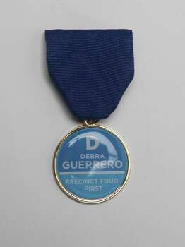 Former City Councilwoman Debra Guerrero, clearly from this Fiesta medal, is running for Bexar County Commissioner, Precinct 4. Photo: Juanito M. Garza, San Antonio Express-News / San Antonio Express-News