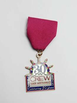 Commercial Real Estate Women, or CREW, of San Antonio will give its Fiesta medals to members and sell them to others for $25 each. To purchase one, contact Cherrie Short, chersource@me.com, or (210) 602-2113. Photo: Juanito M. Garza, San Antonio Express-News / San Antonio Express-News