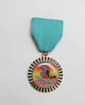 Ballet Folklórico Festival's Fiesta medal is given out to members of its dance company and a limited number of them are given out. Its studio is at 2310 Nogalitos. Photo: Juanito M. Garza, San Antonio Express-News / San Antonio Express-News