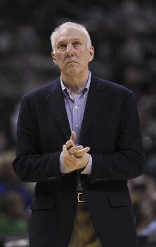 San Antonio Spurs head coach Gregg Popovich looks up during the first half against the Denver Nuggets at the AT&T Center, Wednesday, March 26, 2014. Photo: Jerry Lara, San Antonio Express-News