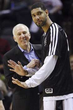 San Antonio Spurs head coach Gregg Popovich and Tim Duncan joke on the bench during second half action against the 76ers Monday March 24, 2014 at the AT&T Center. The Spurs won 113-91. Photo: Edward A. Ornelas, San Antonio Express-News