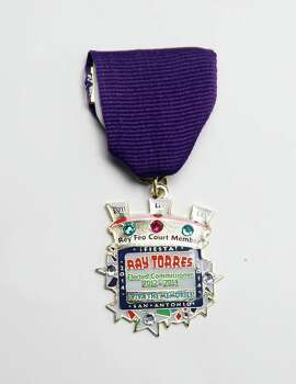Three-time Rey Feo court member Ray Torres, who served under Rey Feos Dick Tips, Brian Weiner and Charlie Garza, will be giving out his medal or will trade at various Fiesta events. Photo: Juanito M. Garza, San Antonio Express-News / San Antonio Express-News