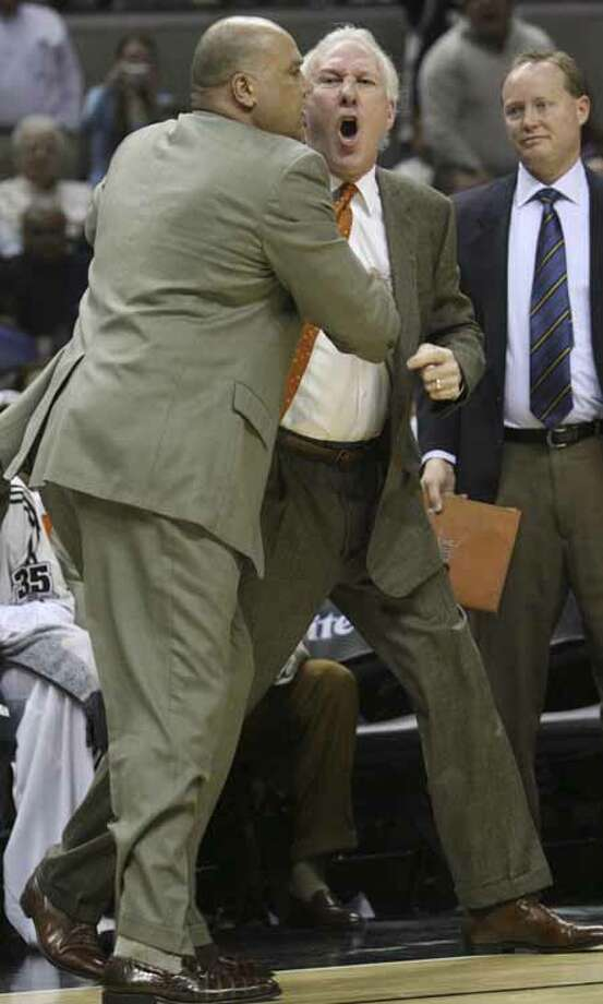 SPTS- Spurs Greg Popovich argues with officials as assistnat Don Newman holds him back and then he is ejected in the 2nd period of play against theIndiana Pacersat the at&t center Thursday March 6 Photo: Delcia Lopez, Express-News File Photo /  © San Antonio Express-News