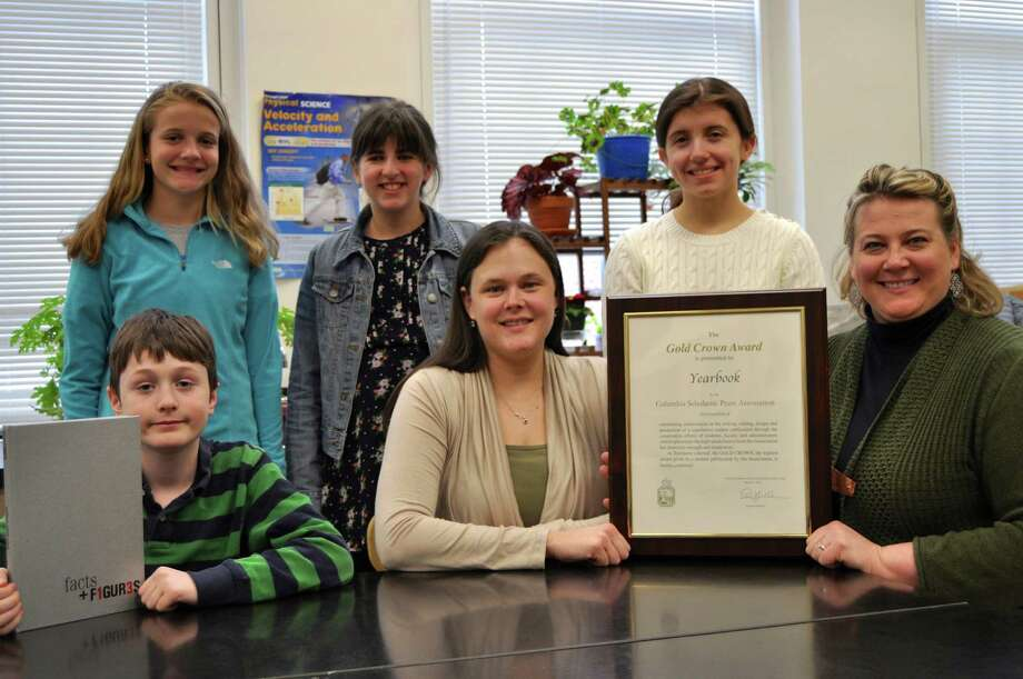 A few members of Middlesex Middle School's yearbook staff celebrate their recent award. They are, back row from left, eighth-graders Sara Moorhead and Kate Stamoulis and ninth-grader Lizzie Borecki. From row, seventh-grader Henry Steinthal and advisers Dana Siano and Liisa Petersen. Photo: Contributed Photo, Contributed / Darien News