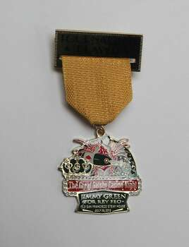 Rey Feo LXVI Jimmy Green comes in with a record number of medals, including this one, the Great Gatsby Casino Night medal Photo: Juanito M. Garza, San Antonio Express-News / San Antonio Express-News