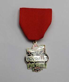 Boysville, Inc.'s Fiesta medal was paid for by Manny Ruiz, who serves on its board of directors, and it will be sold for $10 at the Boysville Thrift Store, 307 W. Olmos. All proceeds will go to the nonprofit. Photo: Juanito M. Garza, San Antonio Express-News / San Antonio Express-News