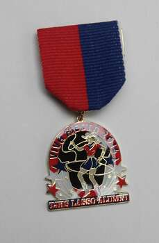 The Thomas Jefferson High School Lasso Alumni Association's Fiesta medal is $5 and can be purchased online at www.lassos.org. Photo: Juanito M. Garza, San Antonio Express-News / San Antonio Express-News