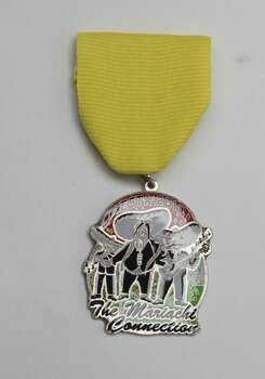 The Mariachi Connection Fiesta Medal will be given away at its store at 2106 W. Commerce, but supplies are limited, www.mariachiconnection.com. Photo: Juanito M. Garza, San Antonio Express-News / San Antonio Express-News