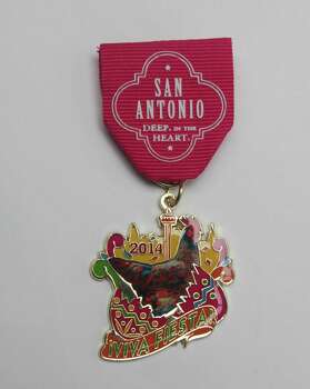 The San Antonio Convention & Visitors Bureau's medal features the Fiesta chicken, which produces the city's colorful cascarones, of course; $9, on sale at the Visitors Information Center on Alamo Plaza. Photo: Juanito M. Garza, San Antonio Express-News / San Antonio Express-News