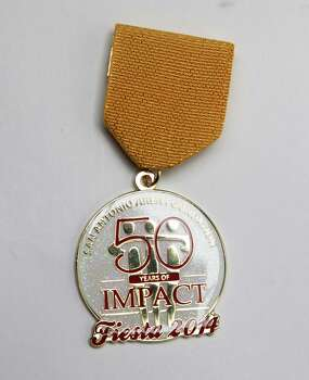 San Antonio Area Foundation's 2014 Fiesta Medal commemorates its half-century of impact on the San Antonio community, not for sale. Photo: Juanito M. Garza, San Antonio Express-News / San Antonio Express-News