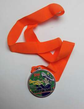 Provenir's Fiesta medal, which dangles from an orange ribbon, will not be sold but traded. The company provides human resources solutions to corporations and businesses. Photo: Juanito M. Garza, San Antonio Express-News / San Antonio Express-News