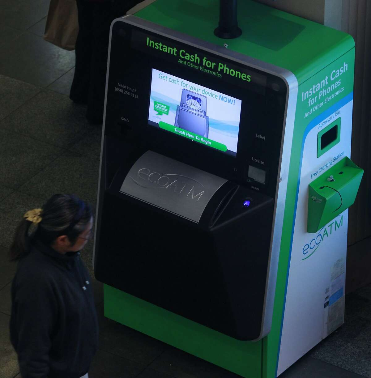A shopper walks past a kiosk that pays instant cash for cellphones at the Westfield SF Centre shopping mall in San Francisco, Calif. on Wednesday, April 2, 2014, but the police are concerned that it provides a way for thieves to cash in quickly on their mobile phone thefts.
