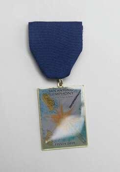 San Antonio Symphony's Fiesta medal. Photo: Juanito M. Garza, San Antonio Express-News / San Antonio Express-News