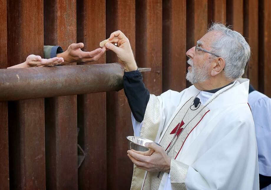Cross-border communion: The Most Reverend Gerald F. Kicanas, bishop of Tucson, offers 