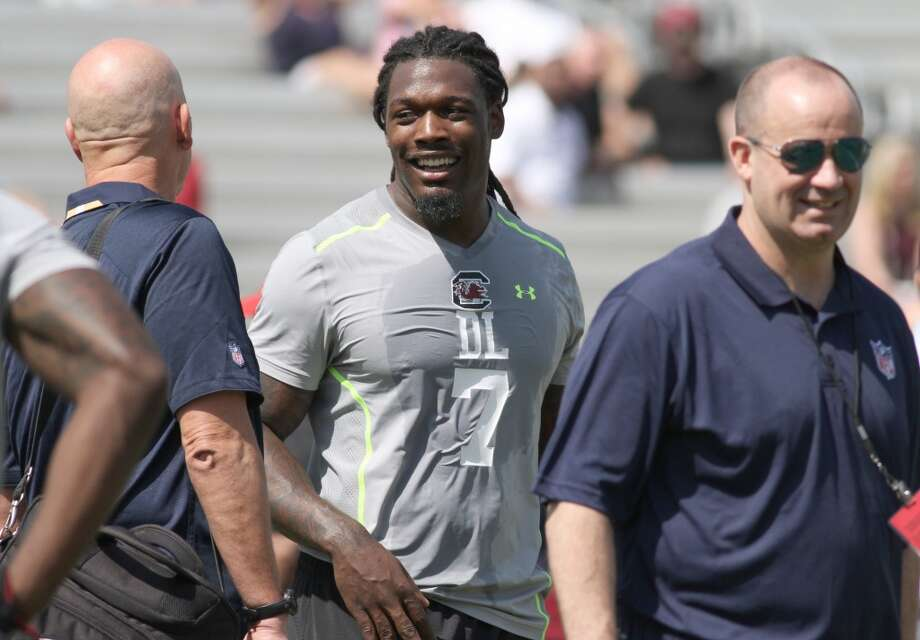 Jadeveon Clowney shares a  laugh with Texans coach Bill O'Brien (right). Photo: Mary Ann Chastain, Associated Press