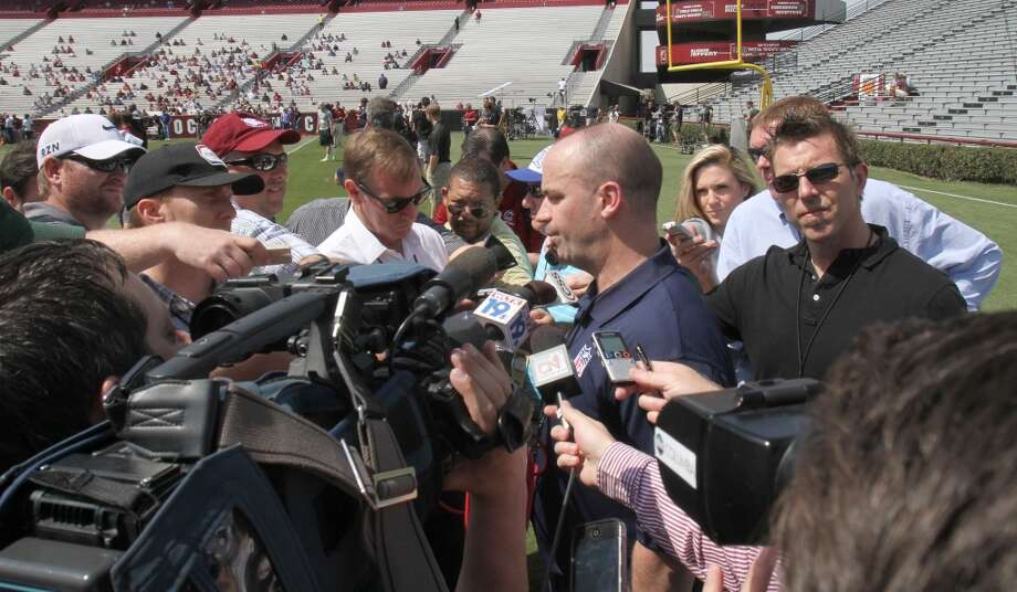 Texans coach Bill O'Brien fields questions from the media after watching Jadeveon Clowney's pro day. Photo: Mary Ann Chastain, Associated Press