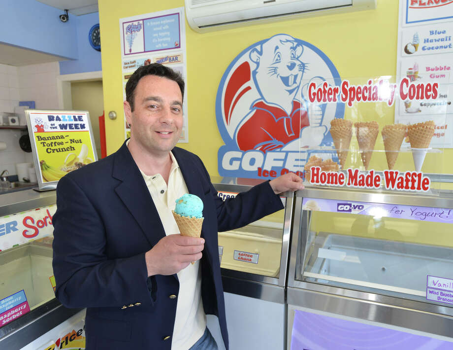 Jay Ragusa, founder of Gofer Ice Cream, holds a cone filled with Blue Monster ice cream at his store in the Cos Cob section of Greenwich, Conn., Tuesday, April 1, 2014. Photo: Bob Luckey / Greenwich Time