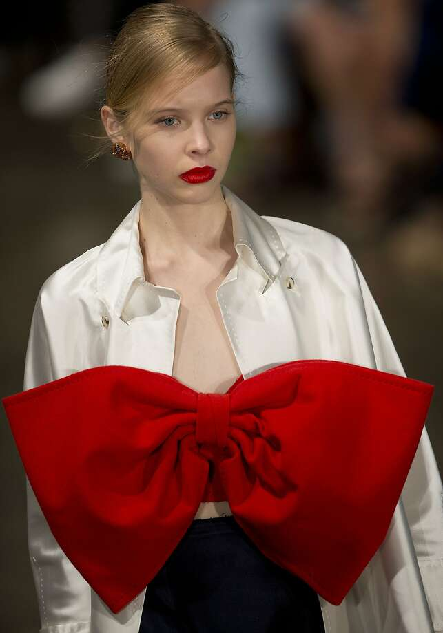 """Ever wonder what they do with those Lexus """"December to Remember"""" car-roof bows? Well, now   you know: A model shows a design by Alexandre Herchcovitch at Sao Paulo Fashion Week. Photo: Andre Penner, Associated Press"""