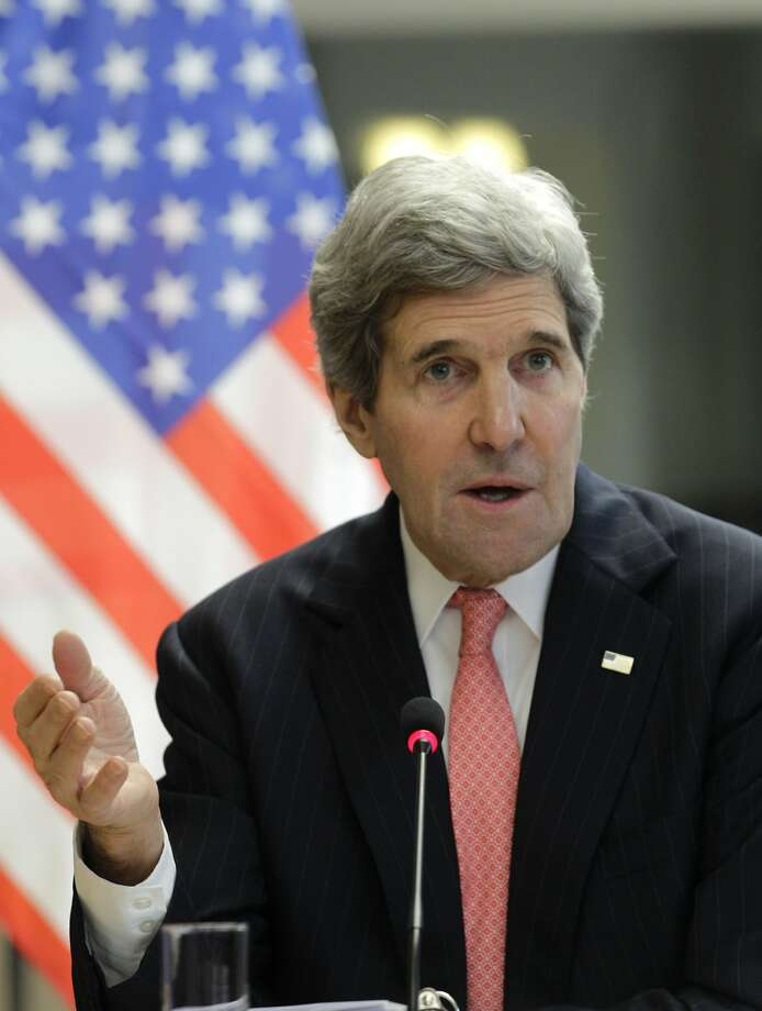 Secretary of State John Kerry speaks during  an EU meeting in Brussels. Photo: Yves Logghe, Associated Press