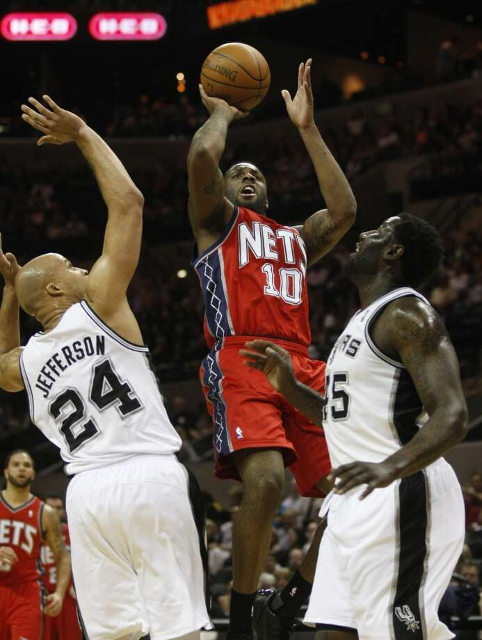 New Jersey Nets forward Damion James (10) shoots over San Antonio Spurs forward Richard Jefferson (24) and San Antonio Spurs forward DeJuan Blair (45) during the first half of their NBA game at the AT&T Center in San Antonio,  Friday, Feb. 25, 2011. Photo: Kevin Martin, San Antonio Express-News