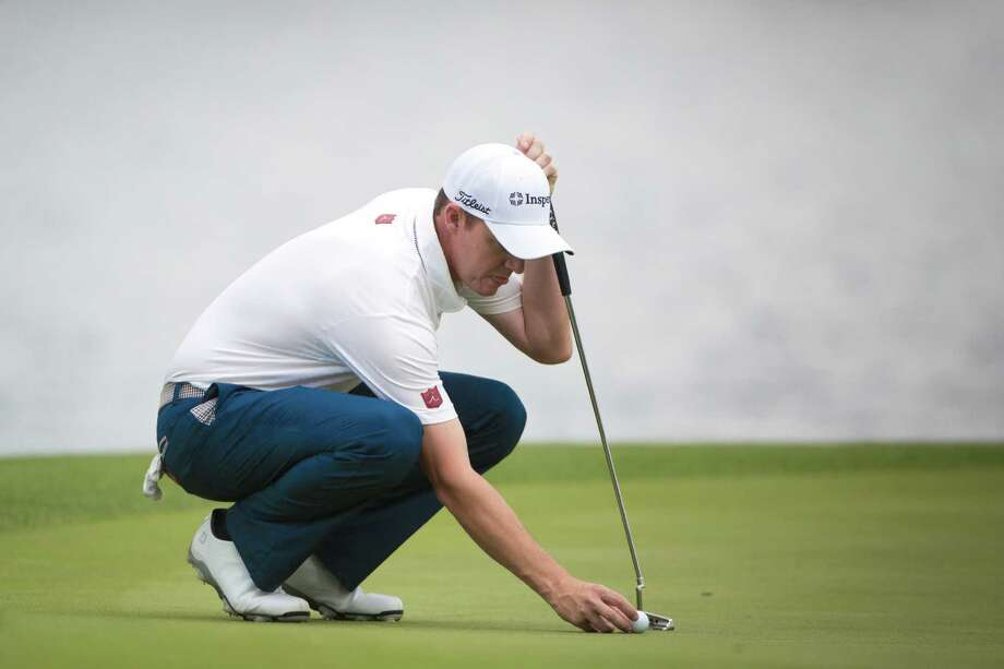 Jimmy Walker places a ball mark on the 3rd hole during the Shell Houston Open Grand Pro-Am, Wednesday, April 2, 2014, in Humble. Photo: Marie D. De Jesus, Houston Chronicle / © 2014 Houston Chronicle