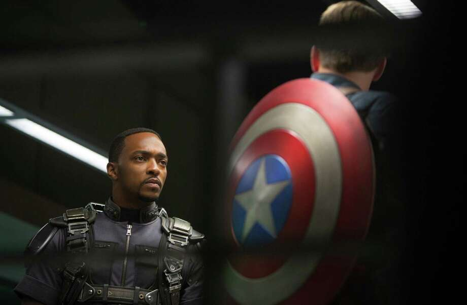 As Captain America, Chris Evans struggles to convey emotion as he bonds with his new bestie (Anthony Mackie, left). Photo: Marvel-Disney / Marvel/Disney