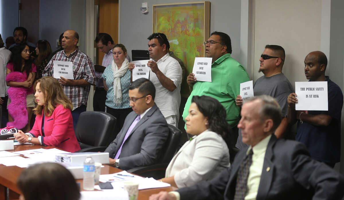 2. In April 2014, a City Council panel first heard from dozens of cabdrivers who argued that the TNCs should play by the existing vehicle-for-hire rules or get out of town. Lyft and Uber worked around city rules by initially not charging for their services, because any financial transactions would have violated the city's vehicle-for-hire ordinance.