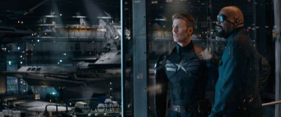 "Chris Evans (left) and Samuel L. Jackson are among the stars in ""Captain America: The Winter Soldier."" Photo: Walt Disney Pictures"