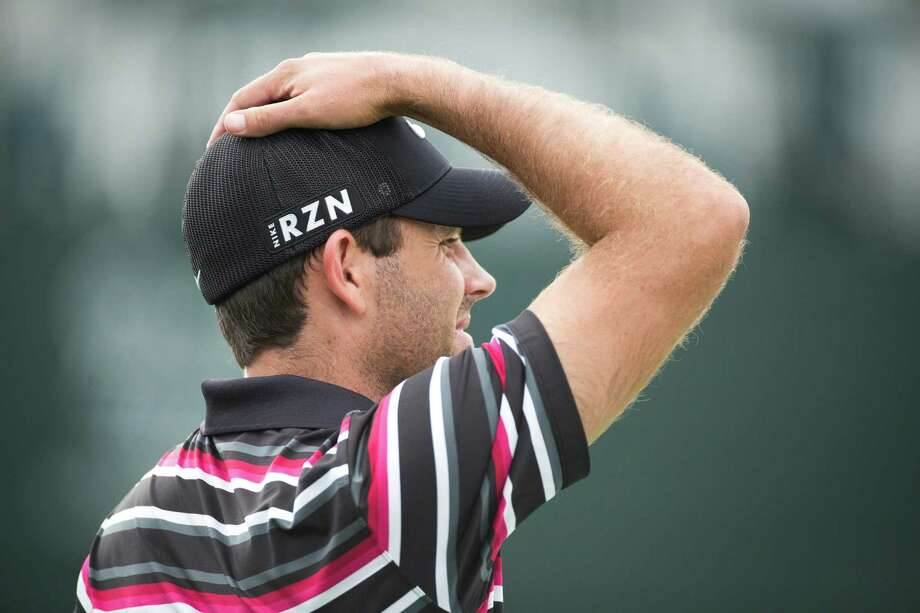 Charl Schwartzel reacts after his golf ball didn't make it to the hole after a short putt on the 17th hole green during the Shell Houston Open Grand Pro-Am on Golf Club of Houston, Wednesday, April 2, 2014, in Humble. Photo: Marie D. De Jesus, Houston Chronicle / © 2014 Houston Chronicle