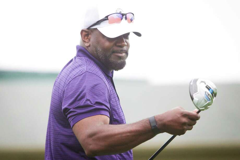 Emmitt J. Smith watches as his golf ball travels from the 1st hole teeing ground during the Shell Houston Open Grand Pro-Am, Wednesday, April 2, 2014, in Humble. Photo: Marie D. De Jesus, Houston Chronicle / © 2014 Houston Chronicle