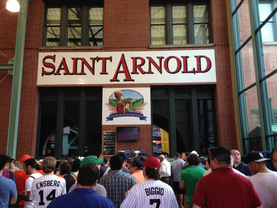 The Saint Arnold-branded bar on the main concourse inside Minute Maid Park, behind the Crawford Boxes in left field, was packed as the Astros prepared to take on the Yankees on Opening Day. Saint Arnold beers also are available in select other spots in the ballpark. (Ronnie Crocker / Beer, TX)