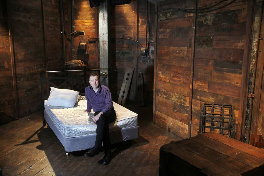 Peter Acworth, owner of the Armory and Kink.com, sits in an adult film production room. The building now houses almost nothing other than porn operations. Photo: Leah Millis, San Francisco Chronicle