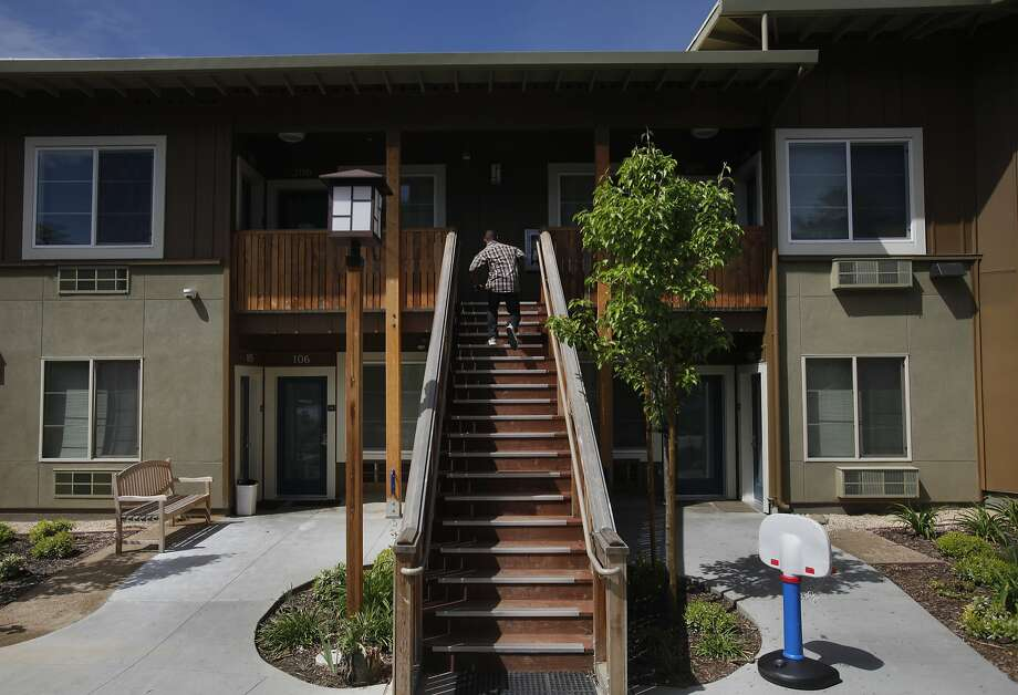 Andrew Sterling, 19, jogs up the stairs to his apartment at Rising Oaks, part of the Fred Finch Youth Center campus in Oakland. The program and housing help people like Sterling who are too old for foster care. Photo: Leah Millis, San Francisco Chronicle