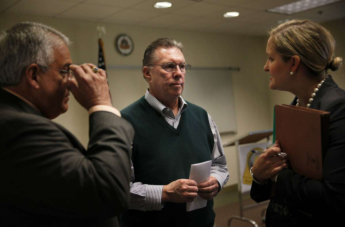 San Bruno Mayor James Ruane (center) speaks with Craig Bettencourt (left) City of San Bruno consultant and special counsel Britt Strottman (right) after a press conference at San Bruno City Hall on Wednesday, April 2, 2014, in San Bruno, Calif. Pacific Gas and Electric Co. was indicted on 12 federal criminal counts related to the 2010 gas pipeline explosion in San Bruno.