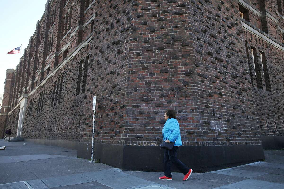 Pedestrians walk past The Armory on 1800 Mission St. April 2, 1014 in San Francisco, Calif.