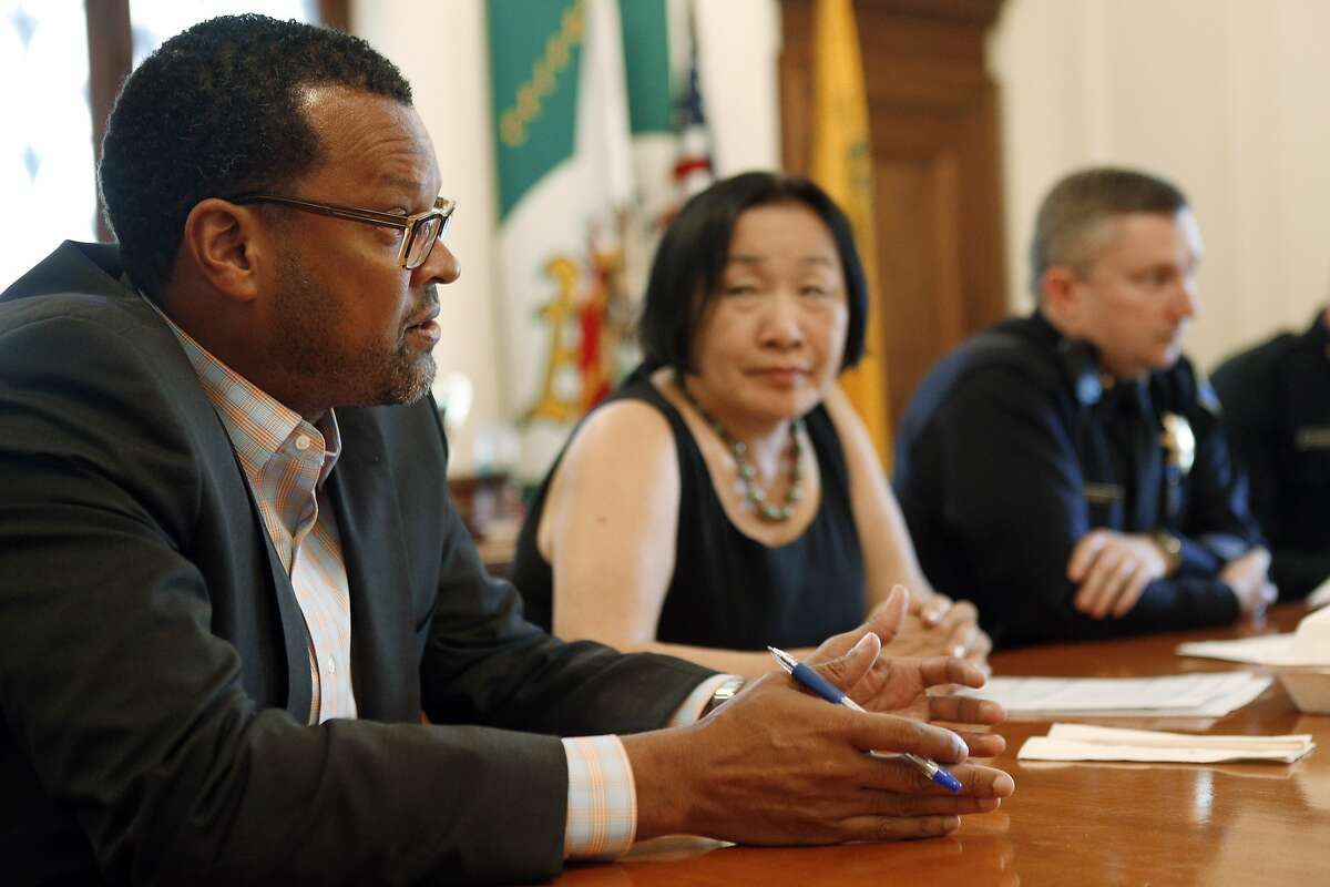 Fred Blackwell, Oakland's new city manager, left, with Mayor Jean Quan, Interim Police Chief Sean Whent, and Interim Assistant Police Chief Paul Figueroa, (not pictured) during a press conference at Oakland City Hall in Oakland, Calif., on Monday, March 24, 2014.