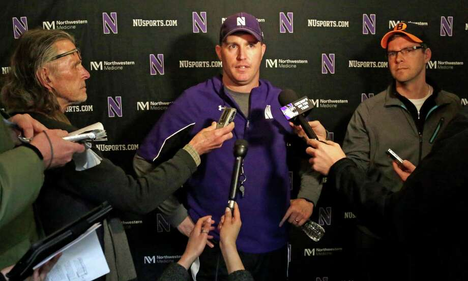 Northwestern head football coach Pat Fitzgerald speaks at a news conference after his football team participated in an NCAA college spring football practice Tuesday, April 1, 2014, in Evanston, Ill. After spring break, Northwestern resumed spring football practices with a huge issue that could change the college sports landscape hanging over their heads. A regional director of the National Labor Relations Board ruled last week that the team can bargain with the school as employees. (AP Photo/M. Spencer Green) ORG XMIT: ILMG103 Photo: M. Spencer Green / AP